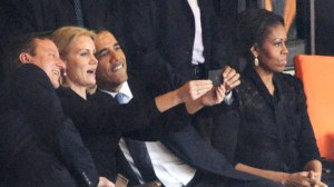 Say cheese: Mrs O does not look impressed with Obama's selfie