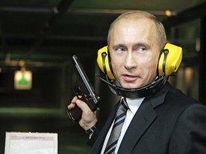 Impaler: Russian President Vladimir Putin prepares to purchase some toothpaste prior to the Sochi Winter Olympics.